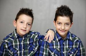 Twins Ilhan and Elhan Hilic pose for a portrait at a primary school in Buzim