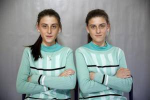 Twins Almedina and Ajla Djulic pose for a portrait in a primary school in Buzim