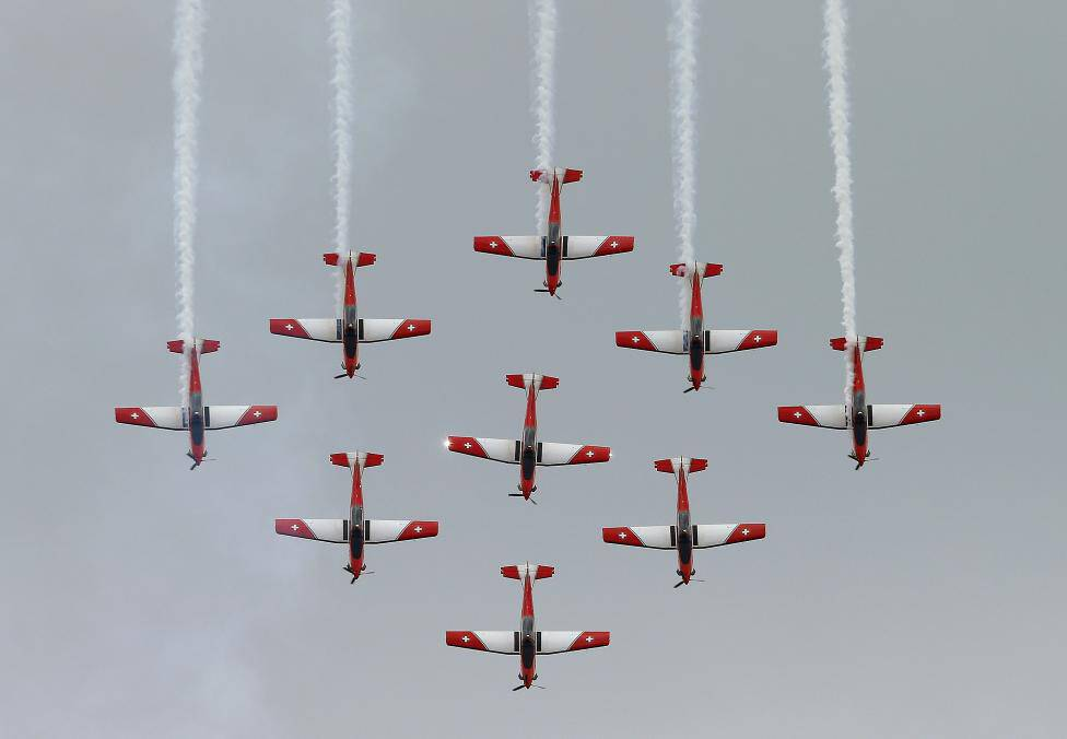 Members of the PC-7 flight team of the Swiss Air Force perform in their Pilatus PC-7 planes in Emmen