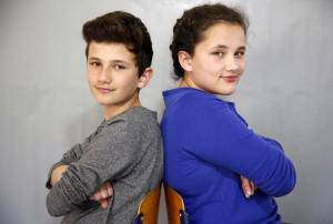 Twins Sara and Samed Dizdarevic pose for a portrait at a primary school in Buzim