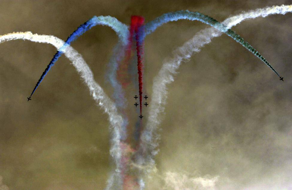 British Royal Air Force Red Arrows squadron performs aerobatics over Athens' Saronic Gulf
