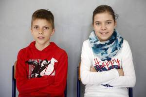 Twins Almina and Almin Duranovic pose for a portrait at a primary school in Buzim