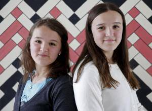 Twins Edita (L) and Elma Pajalic pose for a portrait at a secondary school in Buzim