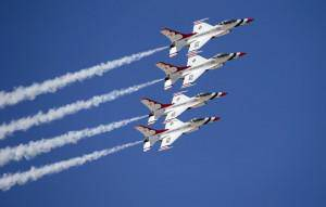 U.S. Air Force F-16 Thunderbirds fly in formation over General William J. Fox Airfield during a media day ahead of the Los Angeles County Air Show in Lancaster