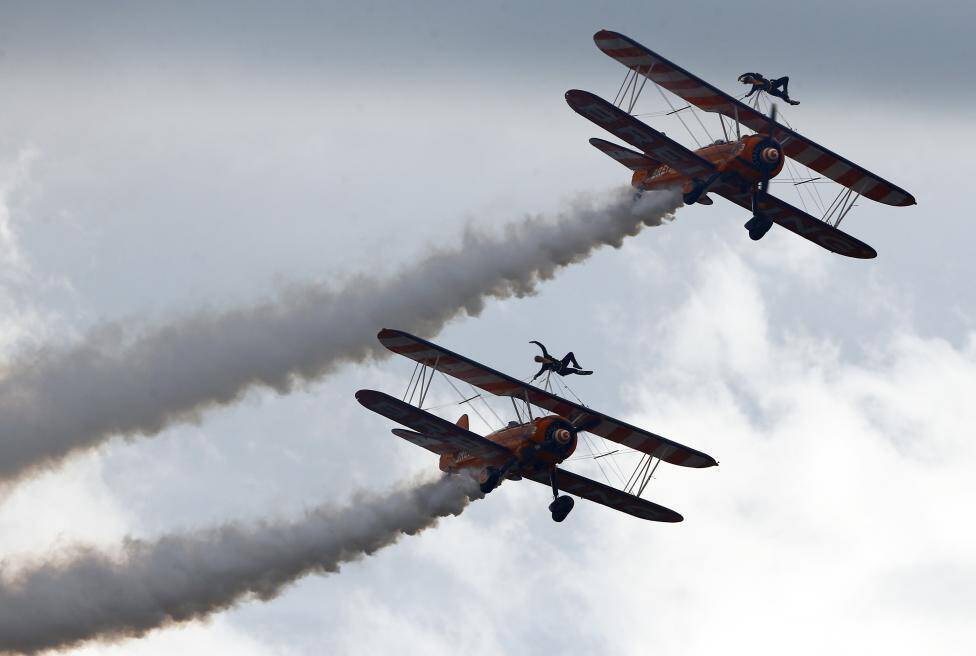 Breitling Wingwalker aircrafts perform during the Air14 airshow at the airport in Payerne