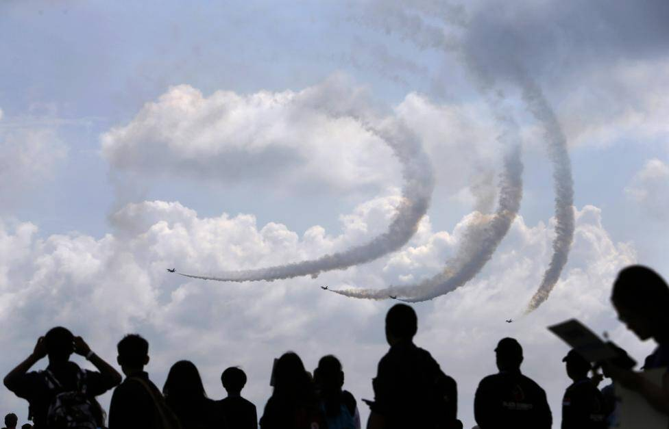 Republic of Singapore Air Force's Black Knights perform a maneuver during an aerial display at the Singapore Airshow