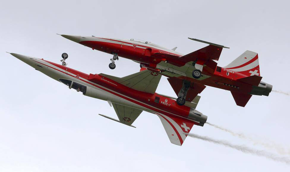 Members of the Patrouille Suisse flight team of the Swiss Air Force perform in their Northrop F-5 ll Tiger fighting jets in Emmen