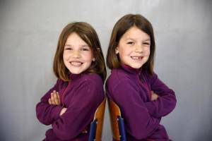 Twins Elma and Selma Burzic pose for a portrait in a primary school in Buzim