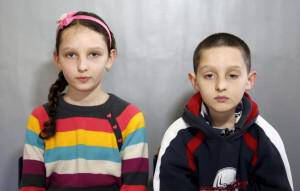 Twins Mubina and Mufid Veladzic pose for a portrait in a primary school in Buzim