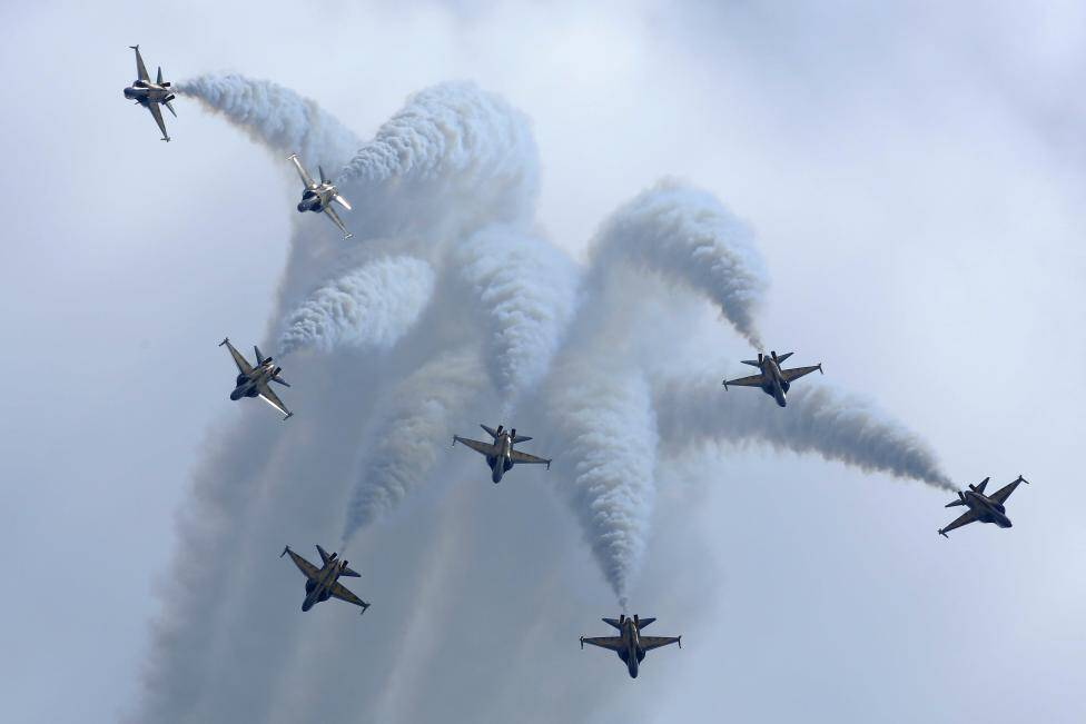 The Black Eagles aerobatic team of ROKAF perform with their T-50 aircraft during the Singapore Airshow